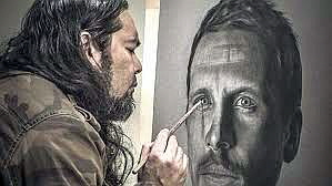Adelaide artist Damien Shen working on his charcoal and pastel portrait of Travis Boak